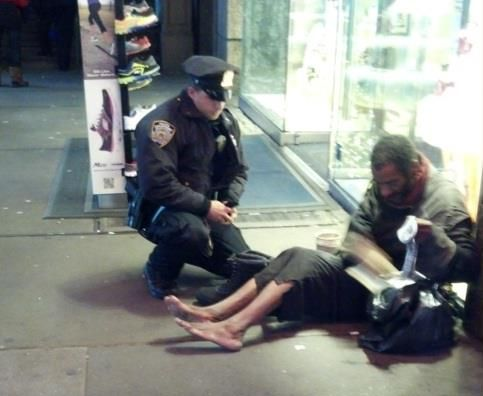 An officer buys a homeless man some shoes.