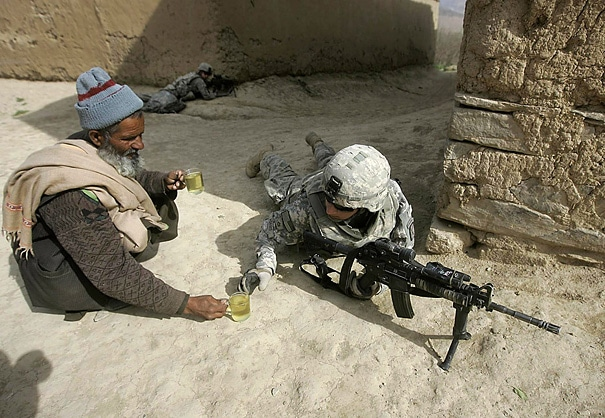 An Afghan man offers tea to a thirsty fighting soldier.